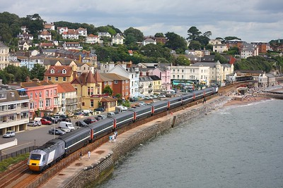 43296 43295 skirt pass Dawlish with 1V45 0700 Manchester Piccadilly to Newquay on 25th July 2009