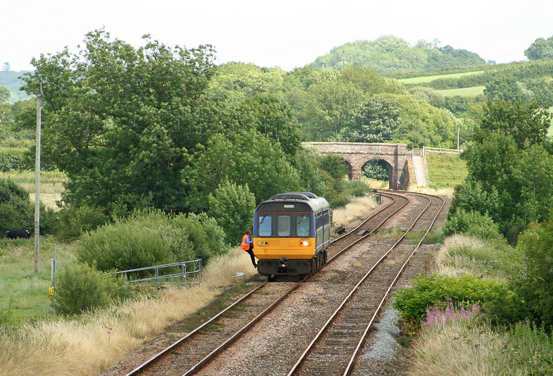 142009, 13.53 Exmouth-Barnstaple, Neopardy, near Yeoford, 15-7-09. Driver has stopped to inspect farm crossing point.