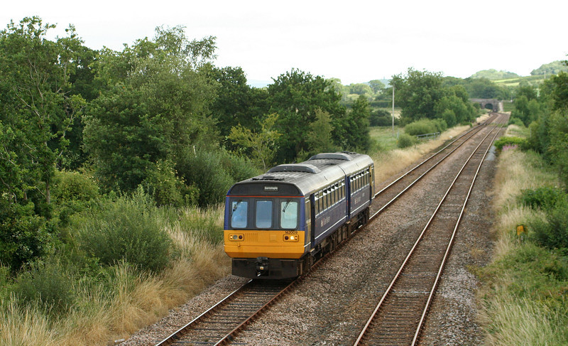 142009, 13.53 Exmouth-Barnstaple, Neopardy, near Yeoford, 15-7-09. Resuming journey after driver hstopped to inspect farm crossing point.