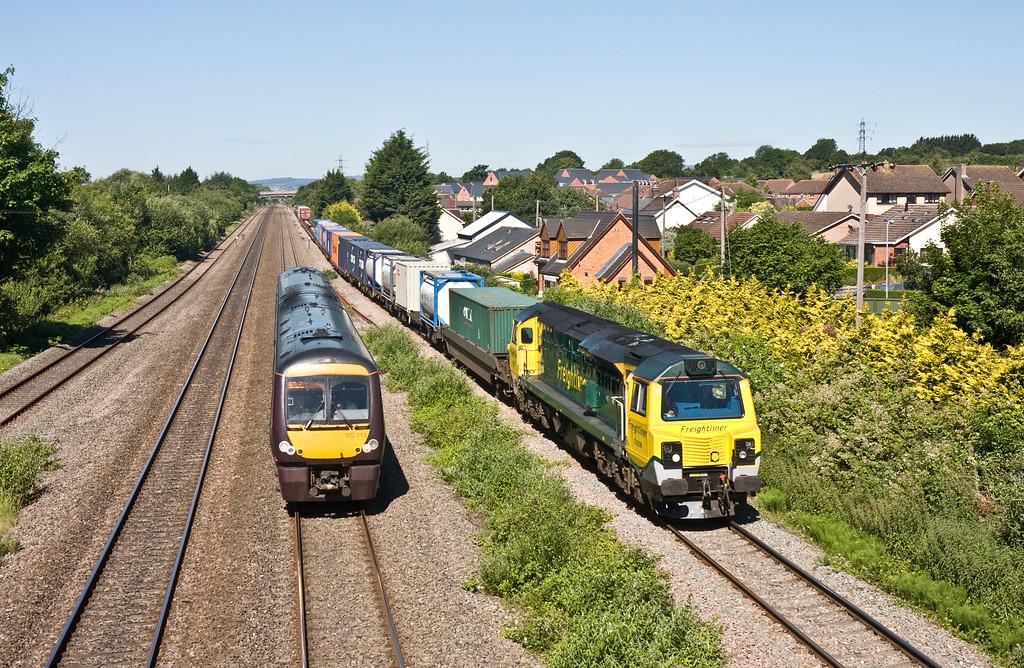 170113, 09.45 Cardiff Central-Nottingham, overtaking 70008, 09.43 Cardiff Wentloog-Southampton MCT, Magor, 30-6-15.