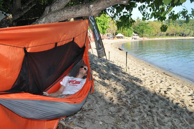A participant gets a little beach nap in his bivouac.