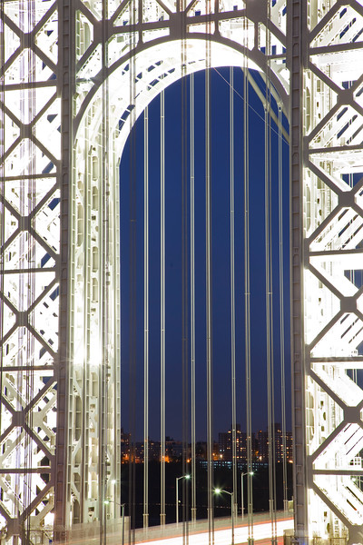The lattice structure of the GW Bridge tower is illuminated by special lights on the 9th anniversary of 9-11