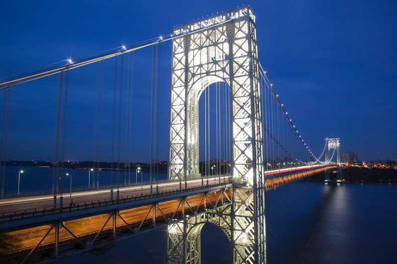 Lattice structure of the GW Bridge towers are illuminated for the 9th anniversary of 9-11
