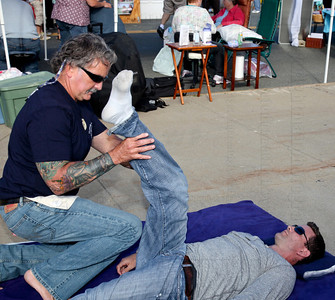 Hull's own Paul Wilson of Nantasket Therapeutic Massage works to loosen up Sean Cusack of Walpole