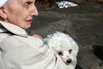 Mary Poor holds her dog Rufus