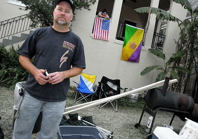 An amazing man and one of his daughters in the front yard of his St. Charles home. This man works at the church pictured below. He and his family remain optimistic about recovery from Katrina. 150 friends and family celebrated Mardi Gras at his house