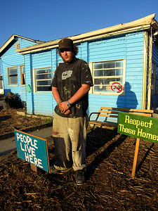 This is Toby. Toby is a hero. This home is a rebuilt home in the 9th Ward where he and other volunteers live. The signs in their yard are a response to the city's wish to bulldoze all homes in the 9th Ward. Toby wants to save all the homes he can.