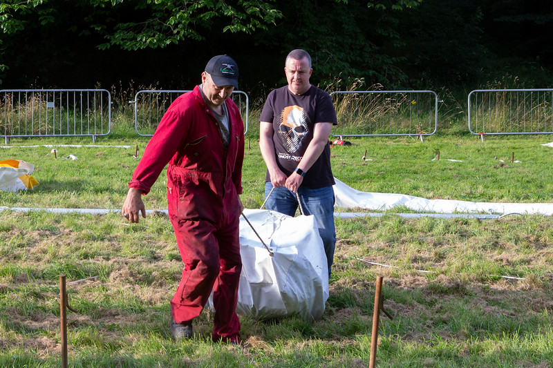 hauling the tent partitions into place