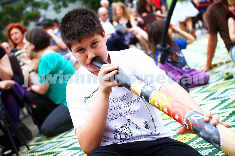 8-12-13. Habayit. Israeli Festival at Beth Weizmann. xxxx plays the didgeridoo. Photo: Peter Haskin