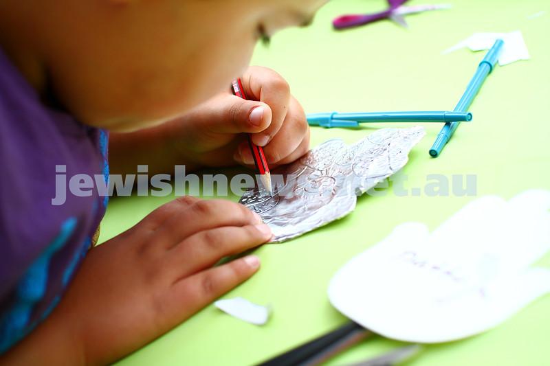 8-12-13. Habayit. Israeli Festival at Beth Weizmann. Kids making hamsas. Photo: Peter Haskin