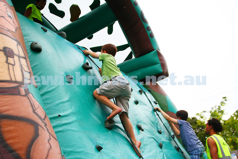 8-12-13. Habayit. Israeli Festival at Beth Weizmann. Inflateable rock wall climbing. Photo: Peter Haskin