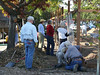 Second corner and trouble.  We cannot get the wire taut around this corner, so Don and Barney cut it off.  Florence, Linda, and Lesley carry off the remnant to see if it will fit the soil bin gate.