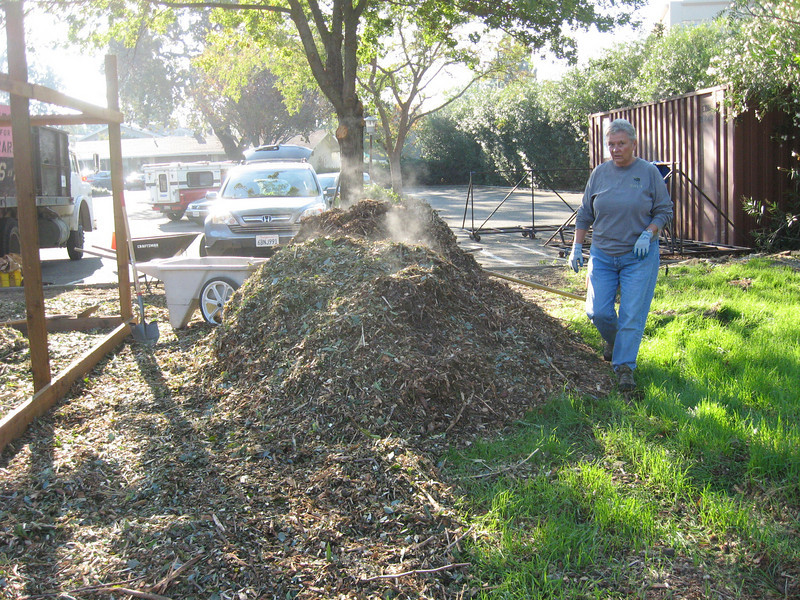 The group began to arrive just as a truck full of mulch pulled up to unload its cargo for us.