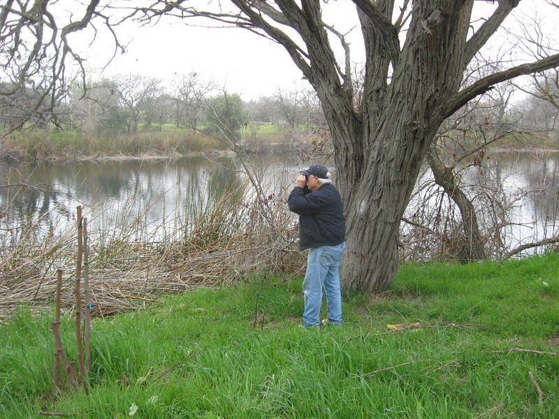 Tom checks the bird life on the lake.