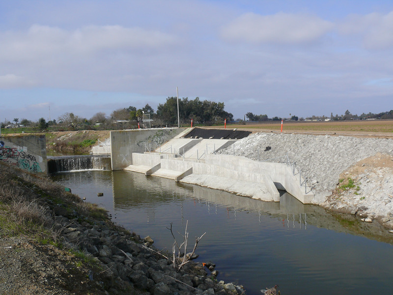 View of completed fish ladder from downstream.  The drop structure is 6 feet high.  There is more structure under water to help guide the fish into the ladder.