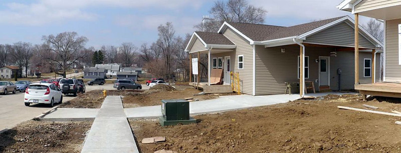 The sidewalk and driveway have been added since the last build date.