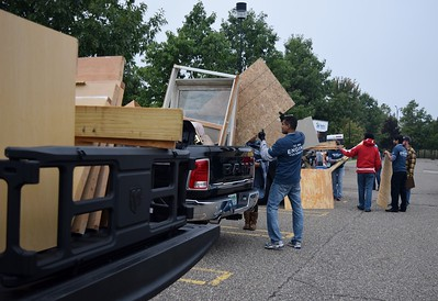 Volunteers unloading materials at the FCA volunteer event for World Habitat Day at the Walter P. Chrysler Museum on Monday, Oct. 3 2016.