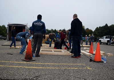 Volunteers building sheds at the FCA volunteer event for World Habitat Day at the Walter P. Chrysler Museum on Monday, Oct. 3 2016.