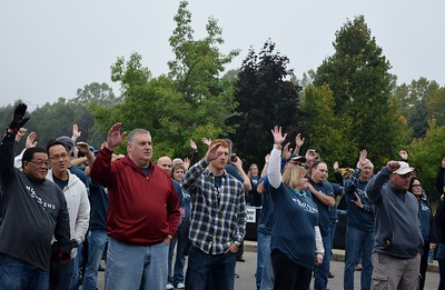 FCA volunteers raise their hands to signify involvement with the FCA Motor Citizens initiative at the FCA volunteer event for World Habitat Day at the Walter P. Chrysler Museum on Monday, Oct. 3 2016.