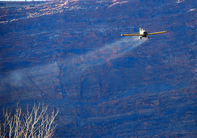 Aircraft drops seed over the Scott M. Matheson Wetlands Preserve, following a fire in October 2008. Photo taken 12-5-08 by Daniel Eddington, Utah Division of Wildlife Resources.