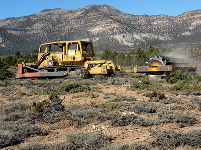 D-8 Caterpillar dozer and roller chopper.  The chopper mulches vegetaton and creates a seed bed for improved seed germination.  This habitat enhancement project is in the Mohrland area north of the town of Huntington, Utah.  It is expected to reduce the incidence of elk-vehicle collisions on Highway 10 and lessen damage to farmers' fences and stored crops in the Cleveland area.  Photo was taken on 10-29-2008 by Daniel Eddington, Utah Division of Wildlife Resources.