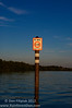 Warm evening light illuminates a sign that helps protect manatees.