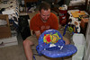 Daddy puttin' together baby's Kick 'N Play bouncy chair
