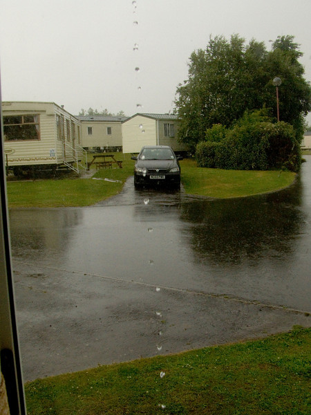 Water running off the caravan roof during the downpour