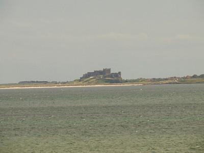 Bamburgh Castle as seen from Lindisfarne Castle