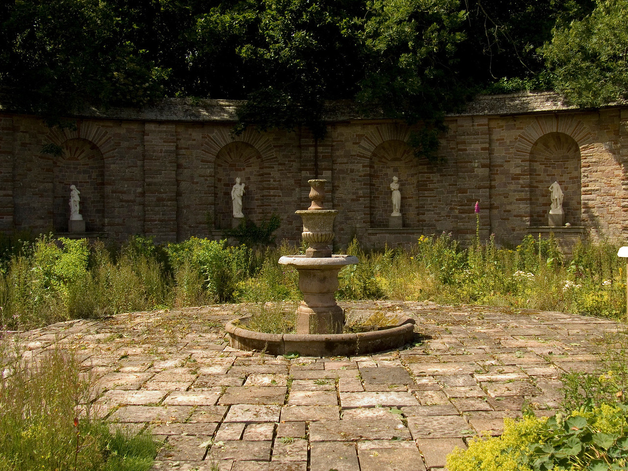 Part of the walled garden that was built by CJ Leyland when he resided at Haggerston House. The water fountain and mock Greek statues are a feature of the garden