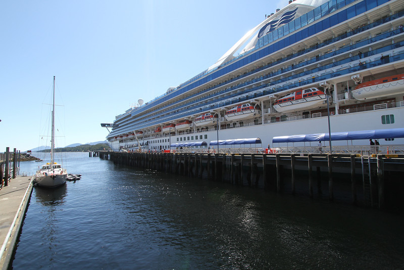 The Island Odyssey dwarfed by the cruise ships