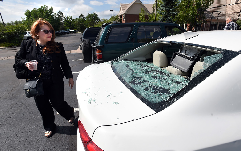 . BEST 2 Adriana Ocampo discovers the hail damage on her rental car  on Tuesday at the Marriott Residence Inn in Louisville.  Cliff Grassmick / Staff Photographer/ June 19, 2018