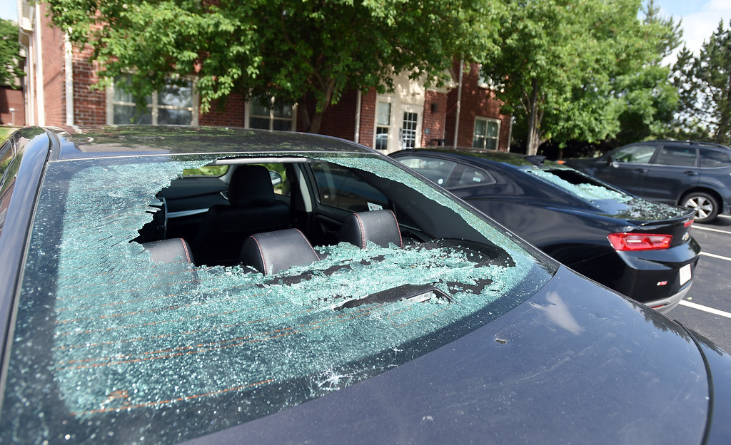 . Several cars were damaged by hail on Monday at the Marriott Residence Inn in Louisville.  Cliff Grassmick / Staff Photographer/ June 19, 2018