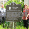 Katie Finlon for Shaw Media<br /> Jeff Marshall and Jessi LaRue pose for a photo after unveiling the Jacob Haish plaque Saturday outside the DeKalb Public Library, 309 Oak St. Haish was Marshall's great-great-great uncle and LaRue's great-great-great-great uncle.