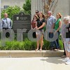 Katie Finlon for Shaw Media<br /> Relatives of Jacob Haish gather around the Haish plaque Saturday outside the DeKalb Public Library.