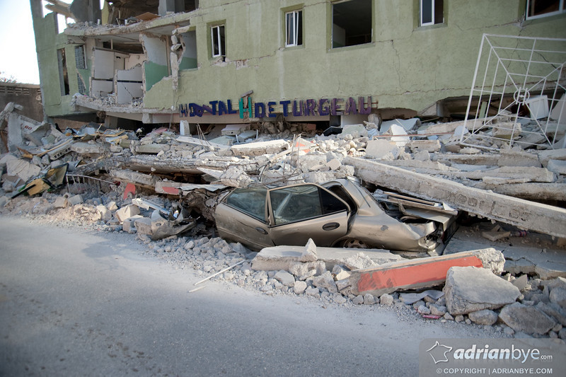 A crushed car outside a restaurant