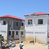 Complex l'Union in Delmas 32 is near completion. August 2016.<br /> <br /> Nearly half of the buildings in the neighborhood of<br /> Delmas 32 were destroyed in the earthquake of 2010.<br /> Today, it's a bustling urban center teeming with life<br /> thanks to the construction of apartment buildings, an<br /> outdoor market, newly-paved roads and sewers.<br /> It's part of PADF's Urban Project for Participatory<br /> Development program (PRODEPUR), financed<br /> by the World Bank and the Caribbean<br /> Development Bank in partnership<br /> with Haiti's Bureau of Monetization of<br /> Development Aid Programs (BMPAD). Union complex is a 24-family apartment unit that includes a basketball court and an amphitheater