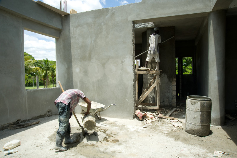 Local laborers work to complete what will soon be the new Immigration and Customs Office near the town of Belladere, in central Haiti. The site is part of a larger complex of administrative buildings for Haitian customs and police officials  being built by PADF through the Haiti Border Stabilization and Reconstruction Initiative (HBI), which has also been working to sensitive local resident son a range of environmental, migration and human rights issues.