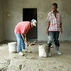 Workers mix cement in what will soon be the new Immigration and Customs office at the border between Haiti and the Dominican Republic, in the town of Belladere. PADF is building the complex, with funding from both the Haitian and Candian governments, as way to regularize border transactions and protect human rights.