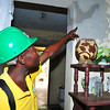 Ministry of Public Works engineers examine repairs made to the home of Marie Edith St. Hilaire, age 63, who lives in Mathieu, Darbonne, near Léogâne, Haiti