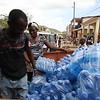 Photos: Jeanty Junior Augustin, Photo journalist Distribution of water and Aquatabs by PADF and RCL in Cavaillon, Haiti
