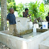 Locals make use of a newly rehabilitated fountain in the village of Gaillard, one of several rehabilitated by a PADF water project near the town of Cayes Jacmel in southeastern Haiti. Through the PADF project, more  than 10,000 local now have access to clean drinking water from natural springs above the town, fed through a pipe system of more than 2.3 kilometers, all installed by PADF.