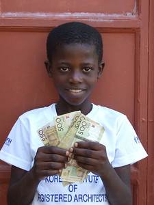 AN2280 Wali Joseph with money for books_ LG