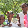 AN13100 Myrthil Siblings with money and goodies brought to Haiti by Dr  David Pound (2)