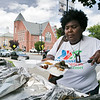 Leominster held it's first Haitian Festival on the common Sunday, September 8, 2019. Ginelle Fils-Aime puts together a plate of Haitian food for a festival goer. SENTINEL & ENTERPRISE/JOHN LOVE