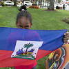 Leominster held it's first Haitian Festival on the common Sunday, September 8, 2019. One of pieces of art at the festival. Anais Jeune, 7, from Fitchburg sjhows off a Haitian flag for sale on her mom's table at the festival. SENTINEL & ENTERPRISE/JOHN LOVE