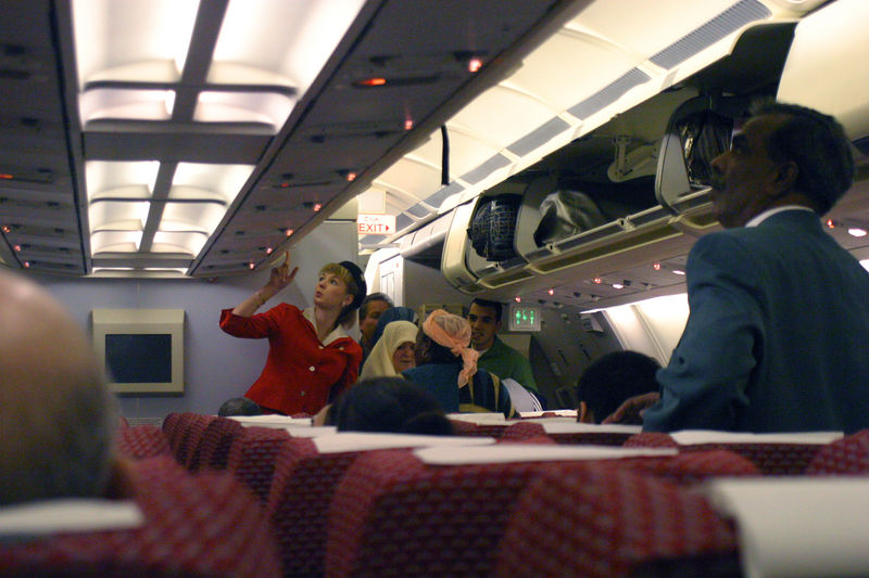 The flight attendent seemed to be making little headway dealing with the passengers.  It seemed that many switched seats on their own and problems rapidly escalated.  It was amusing to see the communication.