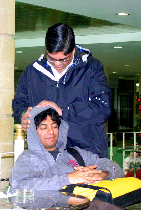 Dr. Rajput giving a massage to Aash.  Notice the large amounts of hair that Aash still has!