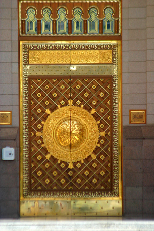 One of the beautifully decorated doors to the mosque.  All decorations in Islam are abstract so as to not represent real objects or creatures.  This has led to development of calligraphy and geometric devices that are elegant and beautiful.