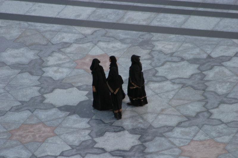 Women in the ornate marble floor.